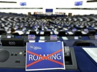 "A paper with the word ""Roaming"", crossed out, is seen on the desk of a Member of the European Parliament during a debate in Strasbourg, March 11, 2015.            REUTERS/Vincent Kessler"