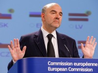 epa04506703 EU Commissioner in charge of Economic and Financial Affairs, Taxation and Customs Pierre Moscovici holds a joint press conference with Vice-President of the EU Commission in charge of the Euro Valdis Dombrovskis and Marianne Thyssen, EU Commissioner in charge of Employment, Social Affairs, Skills and Labour Mobility (both not pictured), on the Autumn 2014 Economic Governance at the EU Commission headquarters in Brussels, Belgium, 28 November 2014. The Annual Growth Survey sets out general economic and social priorities. and the European Commission recommends pursuing an economic and social policy based on three main pillars as first the boost to investment, secondly a renewed commitment to structural reforms, and finally the pursuit of fiscal responsibility.  EPA/JULIEN WARNAND