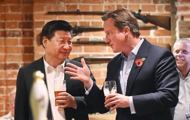 Си Цзиньпин уговаривает Дэвида Кэмерона остаться в Евросоюзе