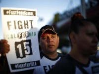 Demonstrators take part in a protest to demand higher wages for fast-food workers outside McDonald's in Los Angeles, California May 15, 2014.  REUTERS/Lucy Nicholson