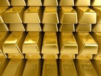 Мировые цены на золото упали до пятилетнего минимума