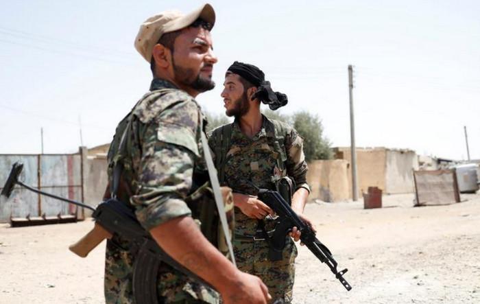Курдские силы хотят завоевать часть Сирии, а не бороться с ИГИЛ, - турецкий министр