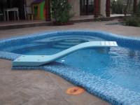 Какие инструменты и оборудование пригодятся для строительства бассейна с трамплином