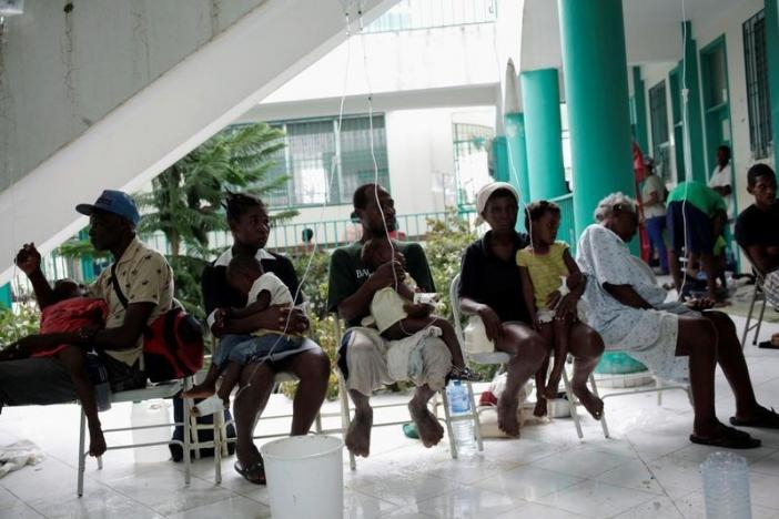 Adults hold children receiving treatment for cholera after Hurricane Matthew in the Hospital of Port-a-Piment, Haiti, October 9, 2016. REUTERS/Andres Martinez Casares