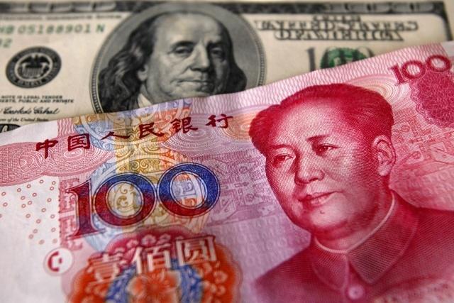 Народный банк Китая укрепил курс юаня по отношению к доллару на 0,5%