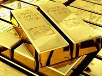 На фоне укрепления доллара золото дешевеет